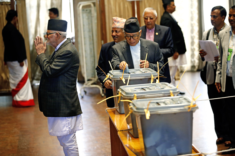 Nepali Congress leader Kul Bahadur Gurung casts his vote for the Presidential post as Former Prime Minister Sushil Koirala (left) greets the members of election committee during the presidential election held at the Legislature-Parliament building in New Baneshwor on Wednesday, October 28, 2015. Photo: Skanda Gautam/ THT