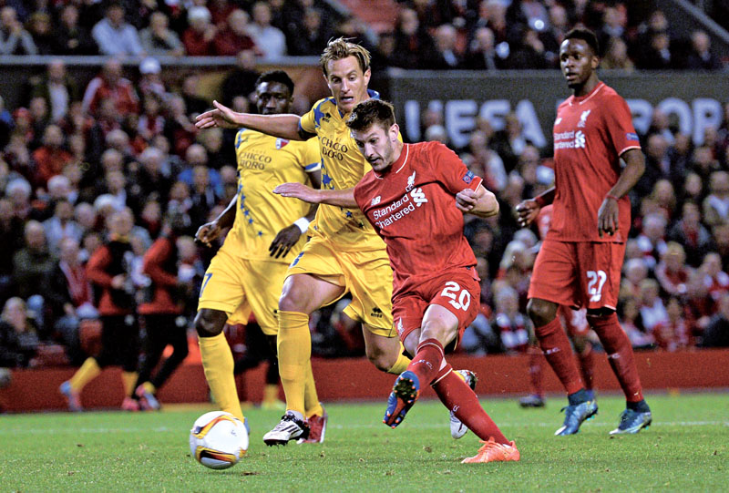 Liverpool's English midfielder Adam Lallana (2nd R) has an unsuccessful shot during the UEFA Europa League group B football match between Liverpool and FC Sion at Anfield in Liverpool, north west England on October 1, 2015. AFP PHOTO / OLI SCARFF
