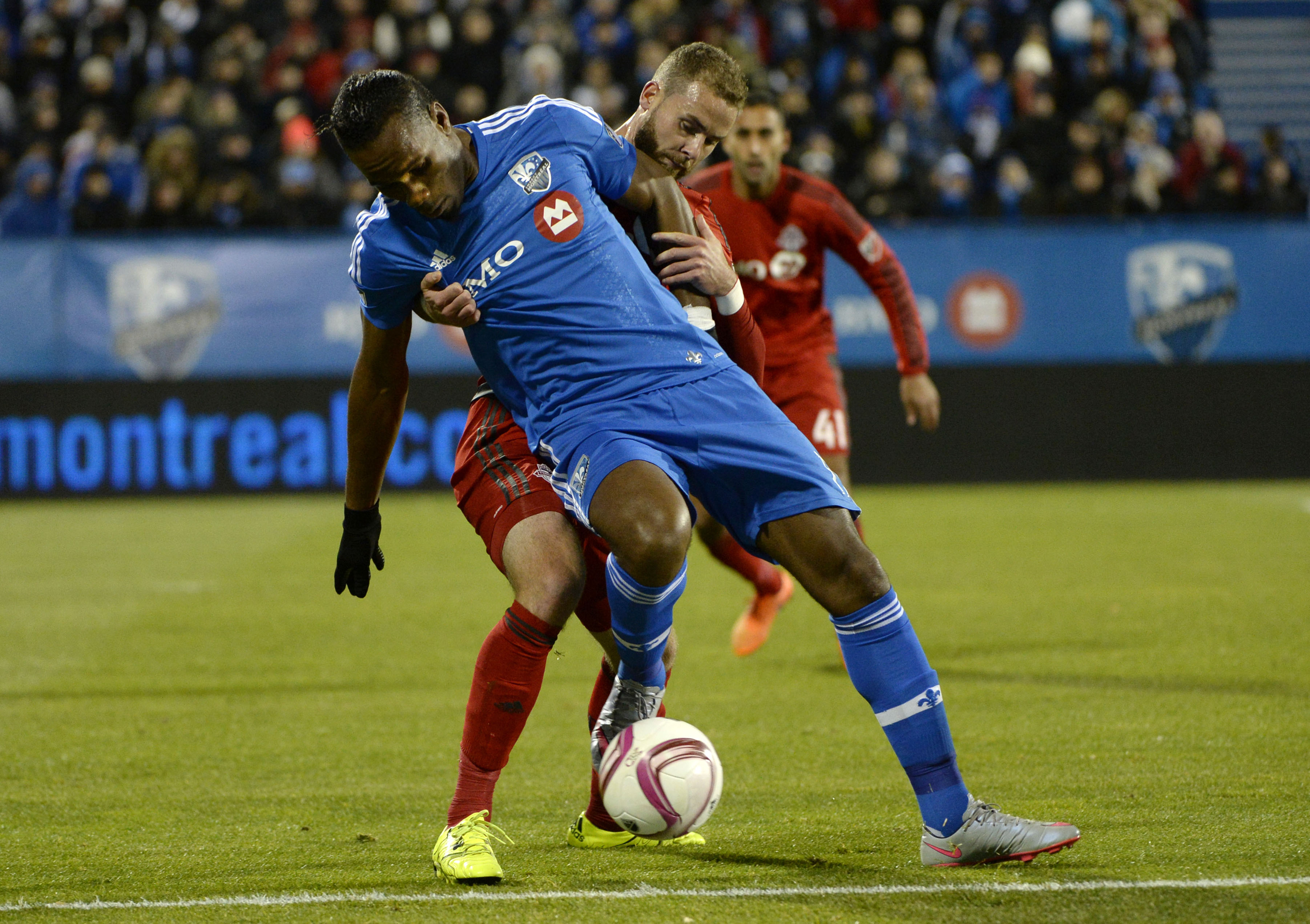 Oct 29, 2015; Montreal, Quebec, CAN; Montreal Impact forward Didier Drogba (11) plays the ball and Toronto FC defender Josh Williams (23) defends during the first half of a knockout round match of the 2015 MLS Cup Playoffs at Stade Saputo. Mandatory Credit: Eric Bolte-USA TODAY Sports