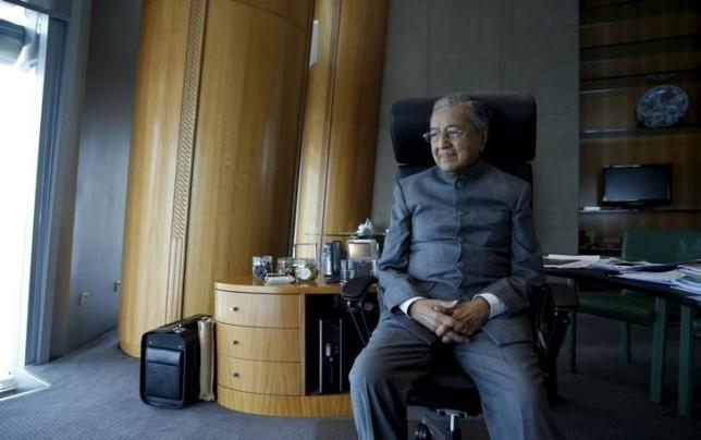 Malaysia's former prime minister Mahathir Mohamad poses for a photograph following an interview with Reuters at his desk in Petronas Towers, Kuala Lumpur, Malaysia, October 22, 2015. MAHATHIR REUTERS/Olivia Harris
