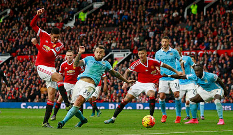 Manchester United v Manchester City, Manchester United's Chris Smalling shoots at goal Action on Sunday, October 25, 2015. Photo: Reuters