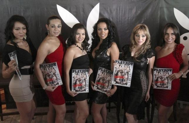 Six former Mexicana Airlines flight attendants pose for photographers while holding the April 2011's Mexican edition of Playboy magazine during a news conference in Mexico City April 11, 2011. The women posed for Playboy after heavily indebted Mexicana suspended all flights in August 2010. Mexicana was one of Mexico's two major airlines and left thousands of ground workers, pilots and flight attendants with no jobs. REUTERS/Carlos Jasso (REUTERS - Tags: ENTERTAINMENT TRANSPORT MEDIA) - RTR2L49C