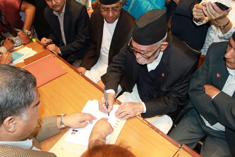 Nepali Congress President Sushil Koirala registers his nomination for the prime ministerial election at the Parliament building on Saturday, October 10, 2015. Photo: RSS