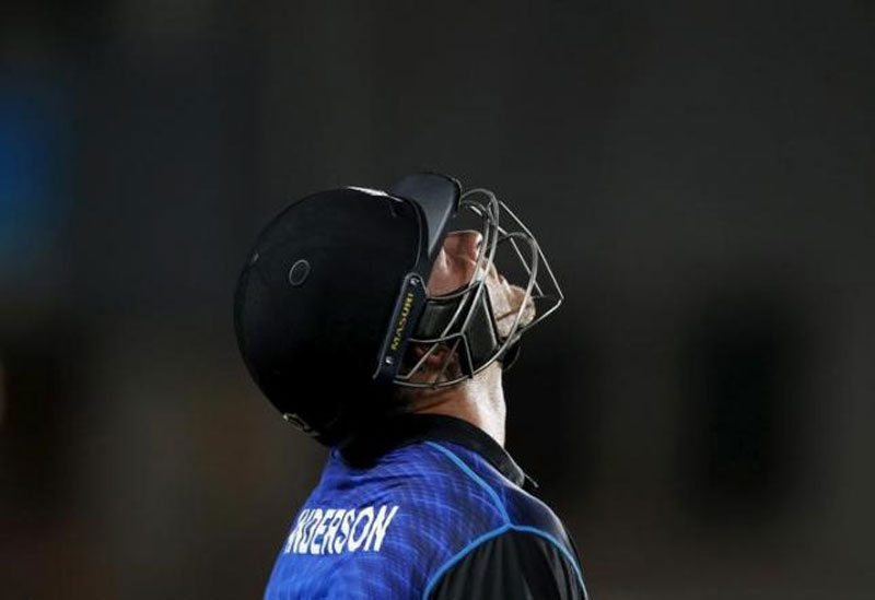 New Zealand's batsman Corey Anderson walks off the field after being caught out by South Africa's Faf du Plessis during their Cricket World Cup semi-final match in Auckland, March 24, 2015. Reuters