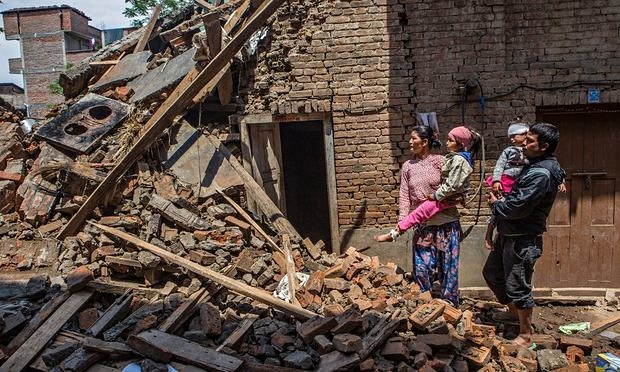 Krishla is cradled by her father as the family survey the wreckage of their home, which collapsed in the Nepal earthquake six months ago. Photograph: Prashanth Vishwanathan/ActionAid