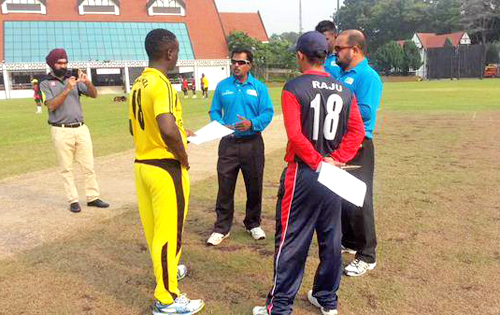 Nepali U-19 cricket team captain Raju Rijal and Uganda's captain  Derrick Bakunzi with the refree for a toss during a match of the ICC Under-19 World Cup Qualifiers in Kuala Lumpur, on Friday, October 16, 2015. Courtesy: CricNepal.com's Facebook Page