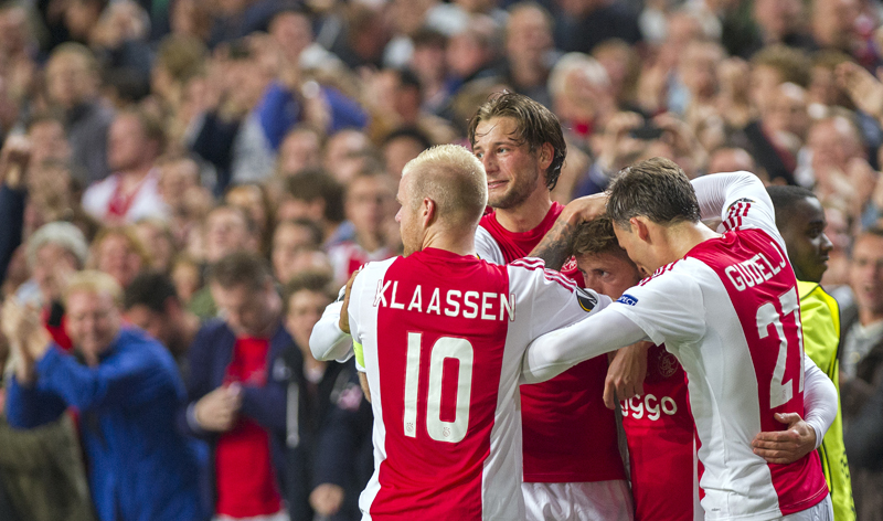 Ajax's Lasse Schone, center, celebrates scoring with teammates Davy Klaassen, left, Mitchell Dijks and Nemanja Gudelj, right, during the Europe League Group A soccer match between Ajax Amsterdam and Celtic Glasgow at the ArenA stadium in Amsterdam, Netherlands, Thursday, Sept. 17, 2015. (AP Photo/Patrick Post)