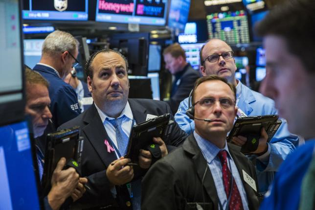Traders work on the floor of the New York Stock Exchange shortly after the opening bell in New York, October 28, 2015.  REUTERS/Lucas Jackson