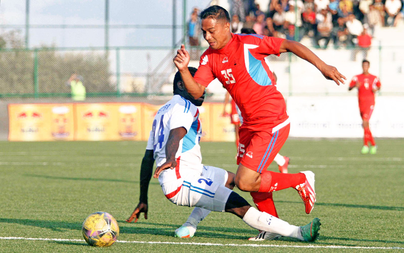 Amrit Basnet (right) of Tribhuvan Army Club being tackled by Peter Segun of Three Star Club during their Red Bull National League match at ANFA Complex in Lalitpur on Thursday. (Credit Image: Udipt Singh Chhetry)