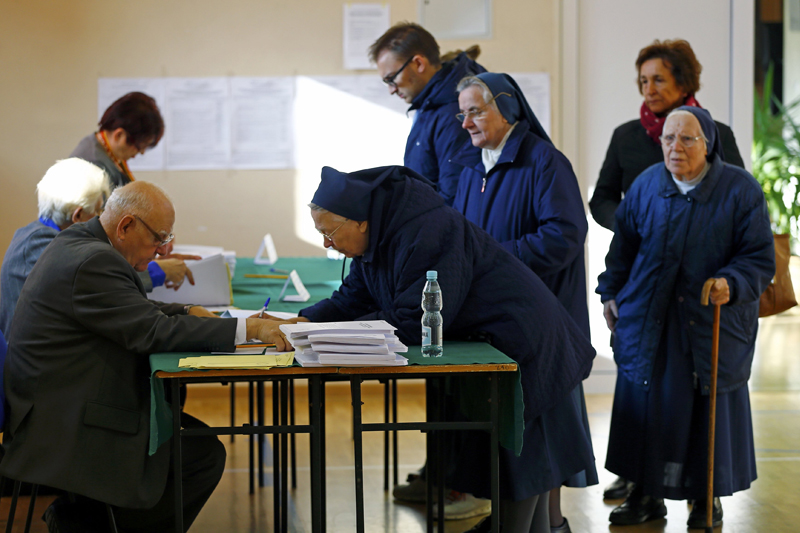 Three Catholic nuns line up to receive their ballots from an official at a polling station in Warsaw, Poland October 25, 2015. Poles vote in an election on Sunday that could end nearly a decade of economic and political stability in the country. Photo: Reuters