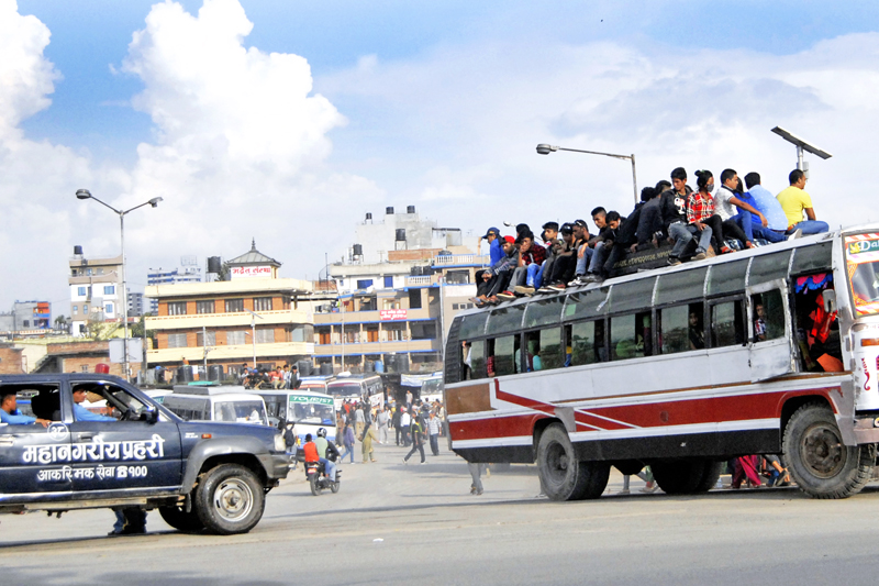 Passengers heading for their hometowns for Dashain at Old Bus Park, Kathmandu on Thursday, October 15, 2015. Photo: THT