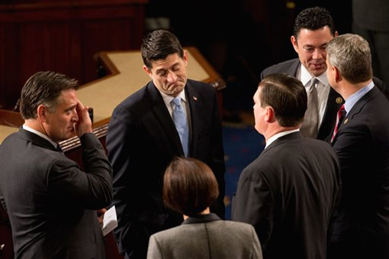 Rep. Paul Ryan, R-Wis. speaks with members of Congress in the House Chamber on Capitol Hill in Washington on Thursday, October 29, 2015, before he is expected to be voted in as the new House Speaker. Photo: AP