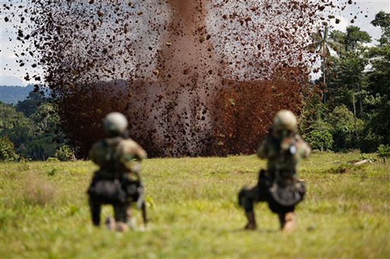 Peruvian counternarcotics police blast a hole in a clandestine airstrip used by cocaine traffickers in Ciudad Constitucion, Peru on July 28, 2015. Photo: AP