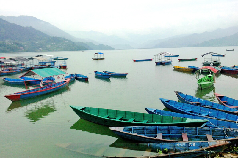 Phewa Lake, a tourist destination, wears a deserted look due to lack of tourists in Pokhara, on Monday. Photo: THT
