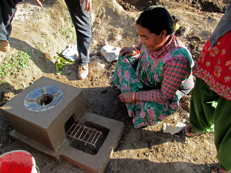 Local woman looks at the improved stove in the Bajura district on Wednesday, October 07, 2015. Photo: Prakash Singh