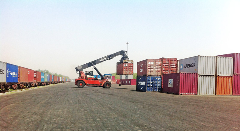 File - Stranded containers being loaded at the dry port in Birgunj, amid the unofficial blockade imposed by India at the border point, on Thursday, October 29, 2015. Photo: Ram Sarraf