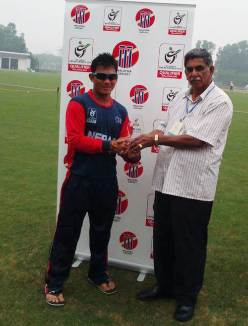 Nepal's Prem Tamang receives the man-of-the -match trophy after their ICC U-19 World Cup Qualifiers match against the United States of America in Kuala Lumpur on Monday. Photo Courtesy: Dinesh Bhatta