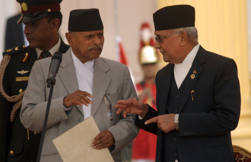 President Ram Baran Yadav and Prime Minister KP Sharma Oli talk to each other before the President administered the oath to the Prime Minister at the Sheetal Niwas, in Kathmandu, on Monday, October 12, 2015. Photo: Bal Krishna Thapa/THT