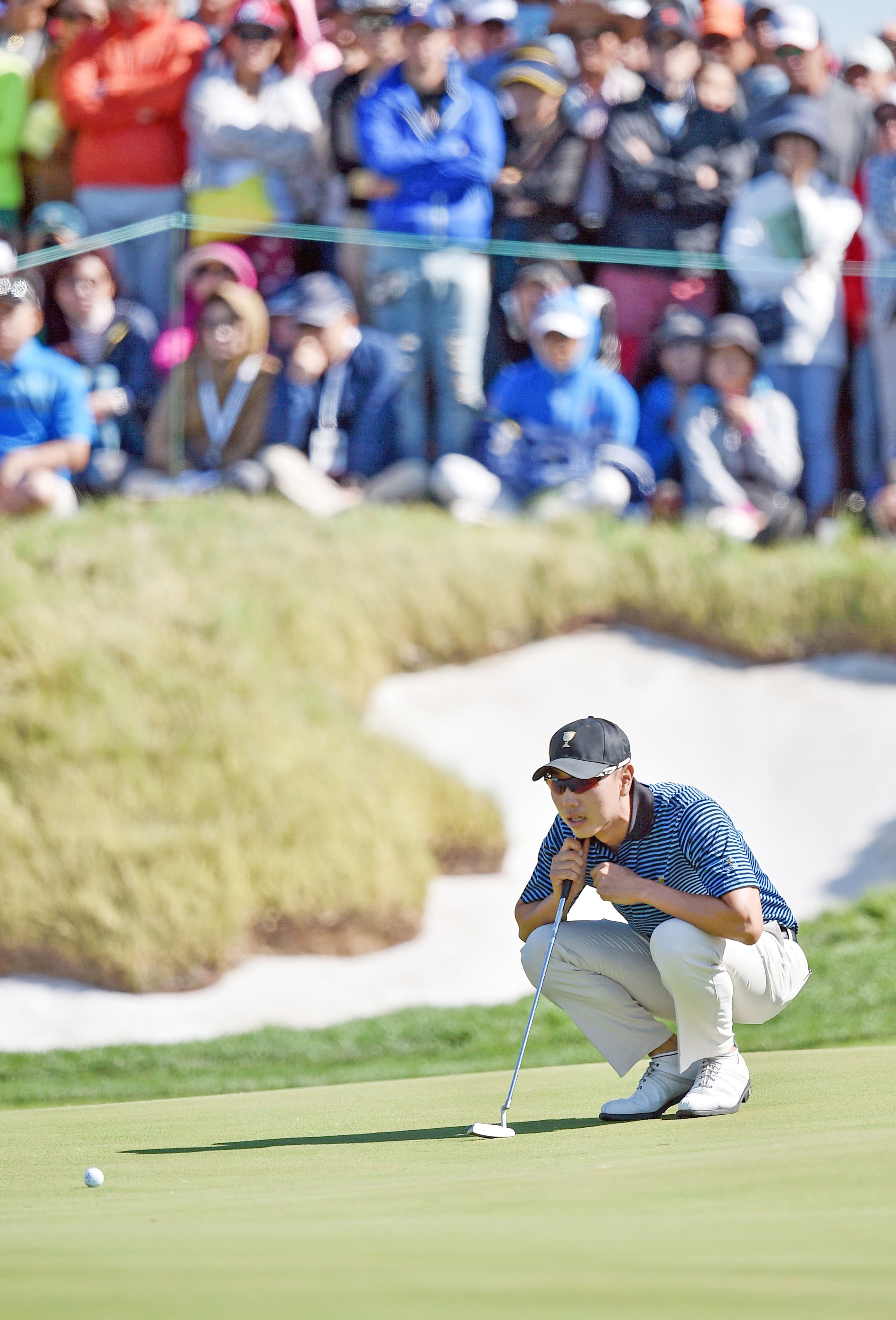 Bae Sang-Moon of South Korea lines up a putt on the 14th hole during the second round match at the Presidents Cup on Friday. Photo: AFP