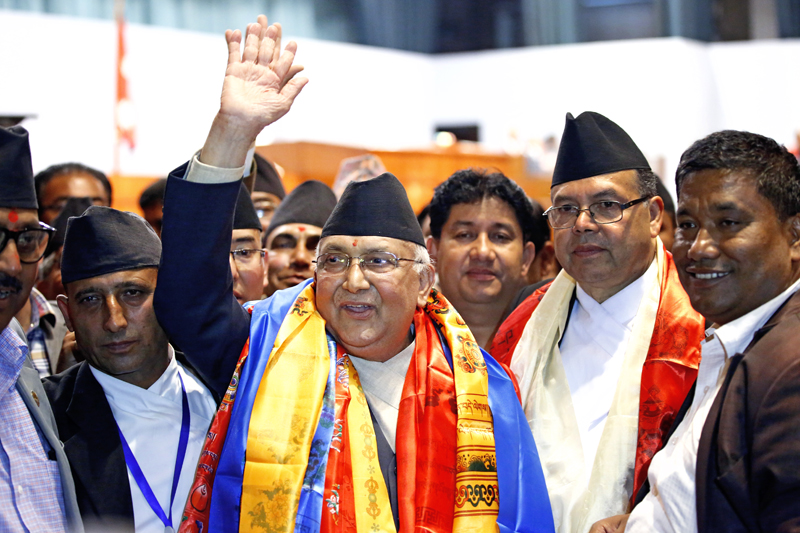 Newly-elected Prime Minister KP Sharma Oli waves to a gathering of people after the meeting of Parliament outside the Legislature-Parliament building, in New Baneshwor, Kathmandu, on Sunday. Photo: Skanda Gautam/ THT