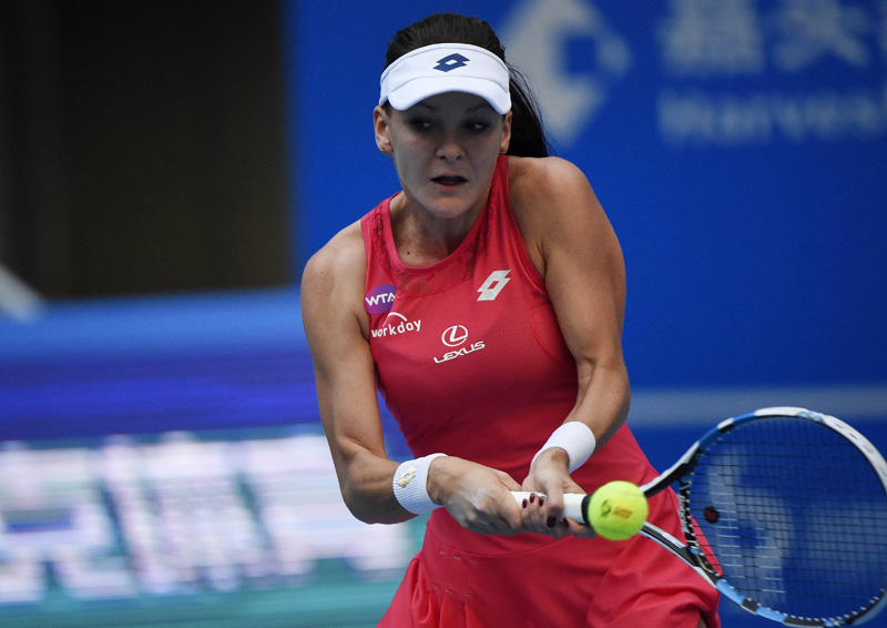 Agnieszka Radwanska of Poland returns to Angelique Kerber of Germany during their quarter-final match at the China Open in Beijing on Friday. Photo: AFP PHOTO
