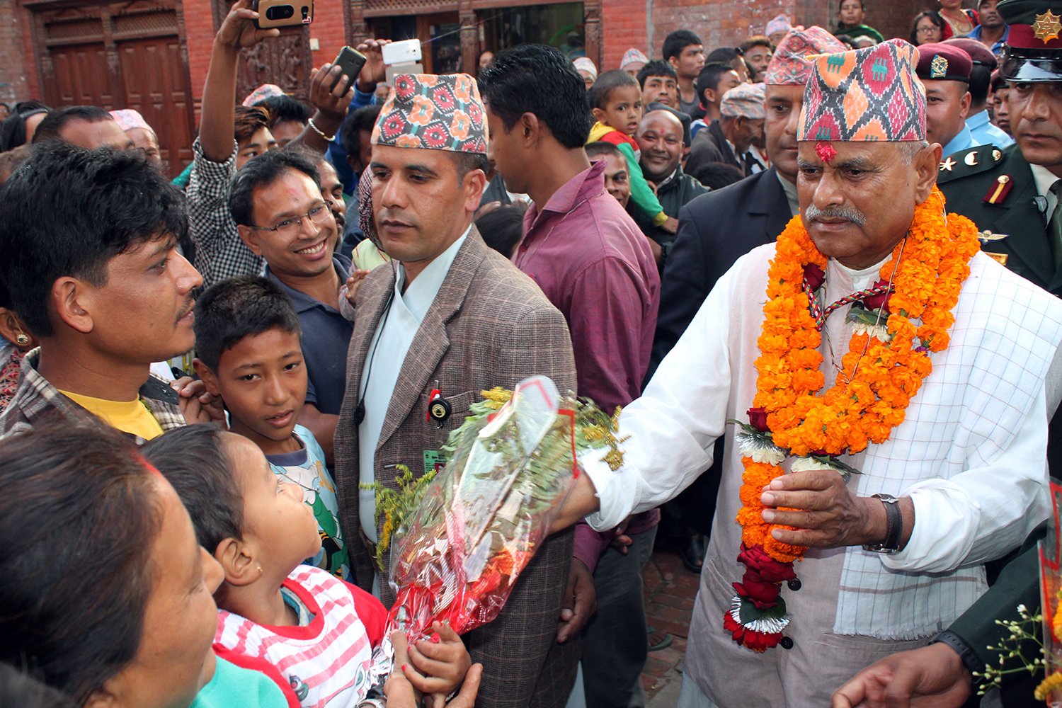 President Ram Baran Yadav meets local people after paying homage to Godness Navadurga on the occasion of Kojagrat Purnima in Bhaktapur  on Monday, October 26, 2015. Photo: RSS