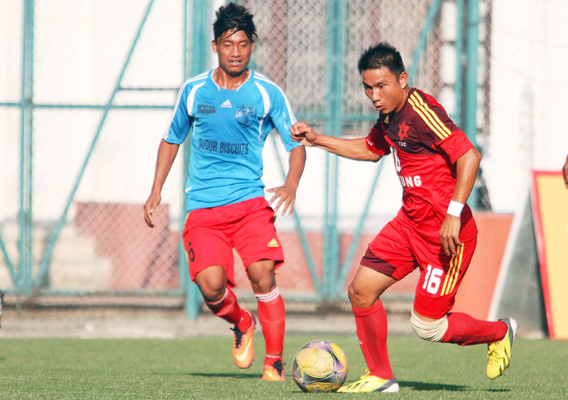Deep Lama (right) of Tribhuvan Army Club dribbles the ball against Amit Tamang of Far-west FC during their Red Bull National League match at the ANFA Complex in Lalitpur on Friday. Photo: Udipt Singh Chhetry/ THT