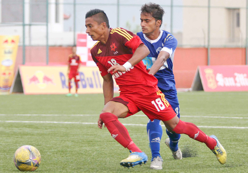 TAC's Nawayug Shrestha (left) beats past NPC's Ajit Bhandari during their Red Bull National League match at the ANFA Complex grounds in Lalitpur on Friday. TAC won the match 3-0. Photo: Udipt Singh Chhetry/THT