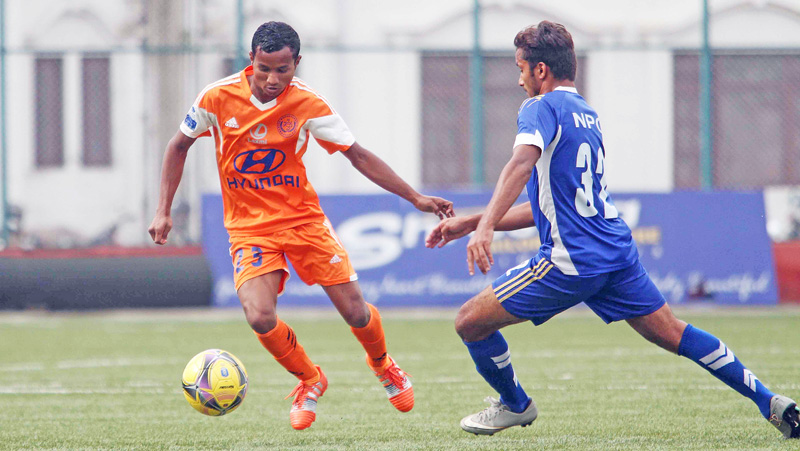 Ravi Paswan (left) of Manang Marshyangdi Club vies for the ball with Ajit Bhandari of nNepal Police Club during their Red Bull National League match in Lalitpur on Wednesday.Photo: Udipt Singh Chhetry/THT