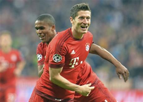 Bayern's Robert Lewandowski, right, and Bayern's Douglas Costa celebrate after scoring during the Champions League group F soccer match between Bayern Munich and Dinamo Zagreb in Munich, Germany, Tuesday, Sept. 29, 2015. AP