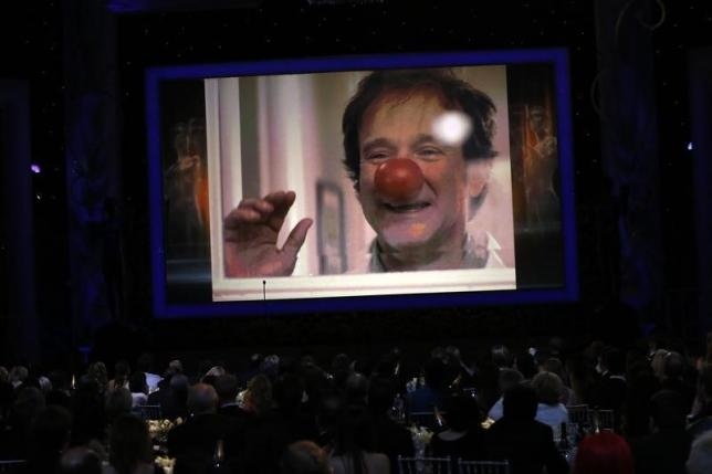 Robin Williams is shown on a large screen during the In Memoriam segment at the 21st annual Screen Actors Guild Awards in Los Angeles, California January 25, 2015.   REUTERS/Mario Anzuoni