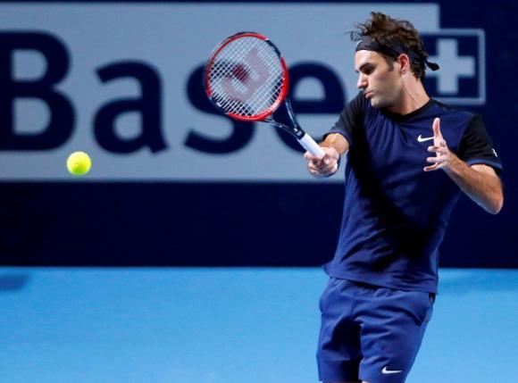 Switzerland's Roger Federer returns the ball to Mikhail Kukushkin of Kazakhstan during their match at the Swiss Indoors ATP men's tennis tournament in Basel, Switzerland October 27, 2015.   REUTERS/Arnd Wiegmann