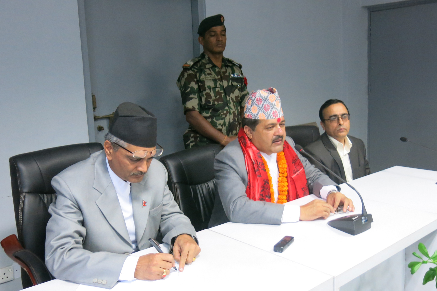 Newly appointed Minister for Law, Justice and Parliamentary Affairs Agni Prasad Kharel  giving instruction to the officials after he assumed his post in Kathmandu, on Monday. Photo: RSS