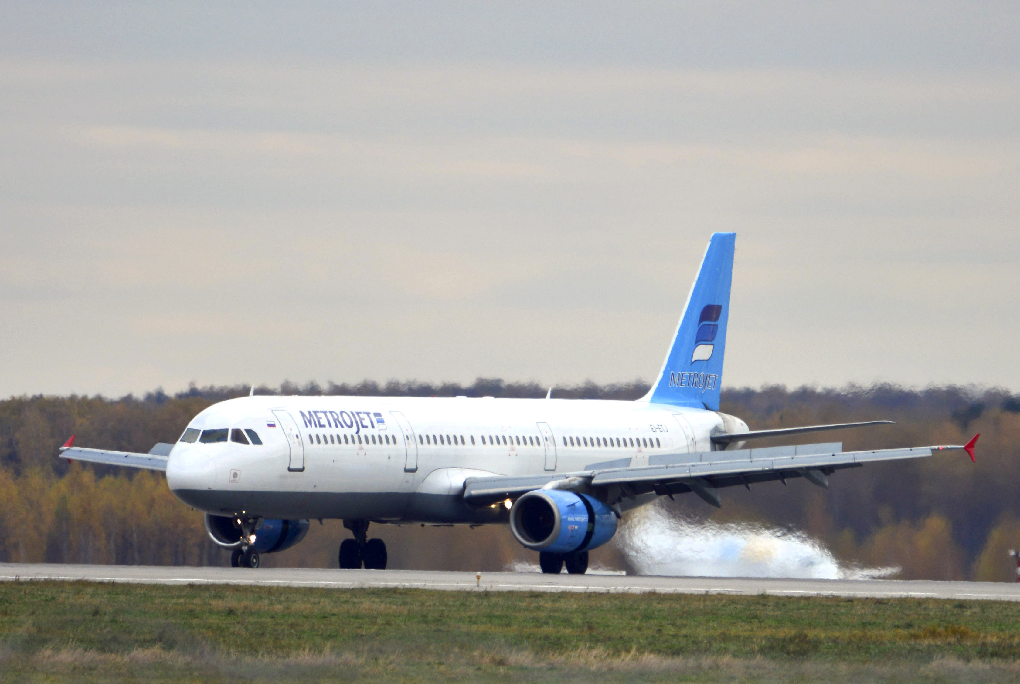 ALTERNATIVE CROP - In this photo taken on Tuesday, Oct. 20, 2015, The Russian airline Kogalymaviau0092s Airbus A321 with a tail number of EI-ETJ on an airstrip of Moscowu0092s Domodedovo international airport, outside Moscow, Russia.  Russia's civil air agency is expected to have a news conference shortly to talk about the Russian Metrojet passenger plane EI-ETJ, that Egyptian authorities say has crashed in Egypt's Sinai peninsula. (AP Photo/Tatiana Belyakova)