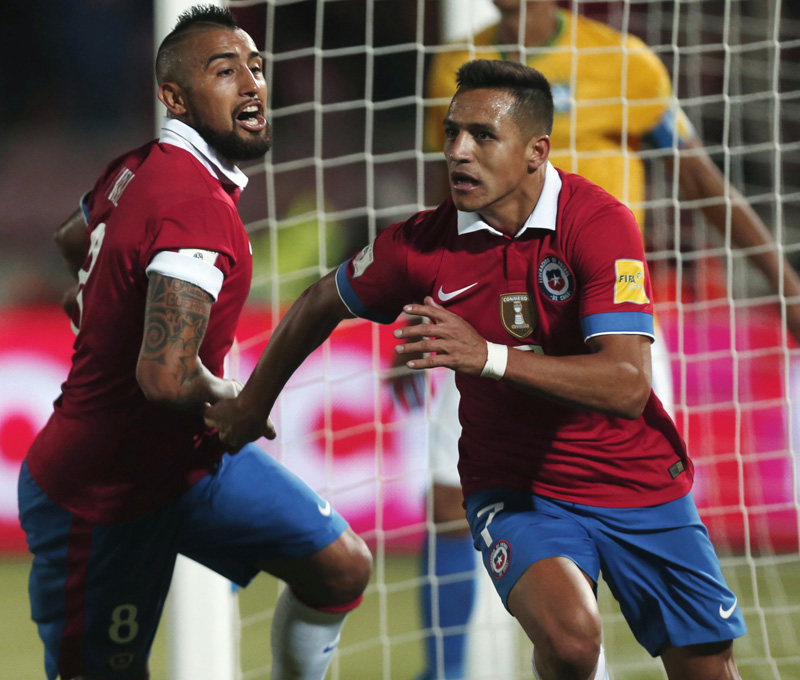 Chile's Alexis Sanchez (right) and Arturo Vidal celebrate after scoring a goal against nBrazil during their 2018 World Cup qualifying match in Santiago on Thursday. Photo: AP