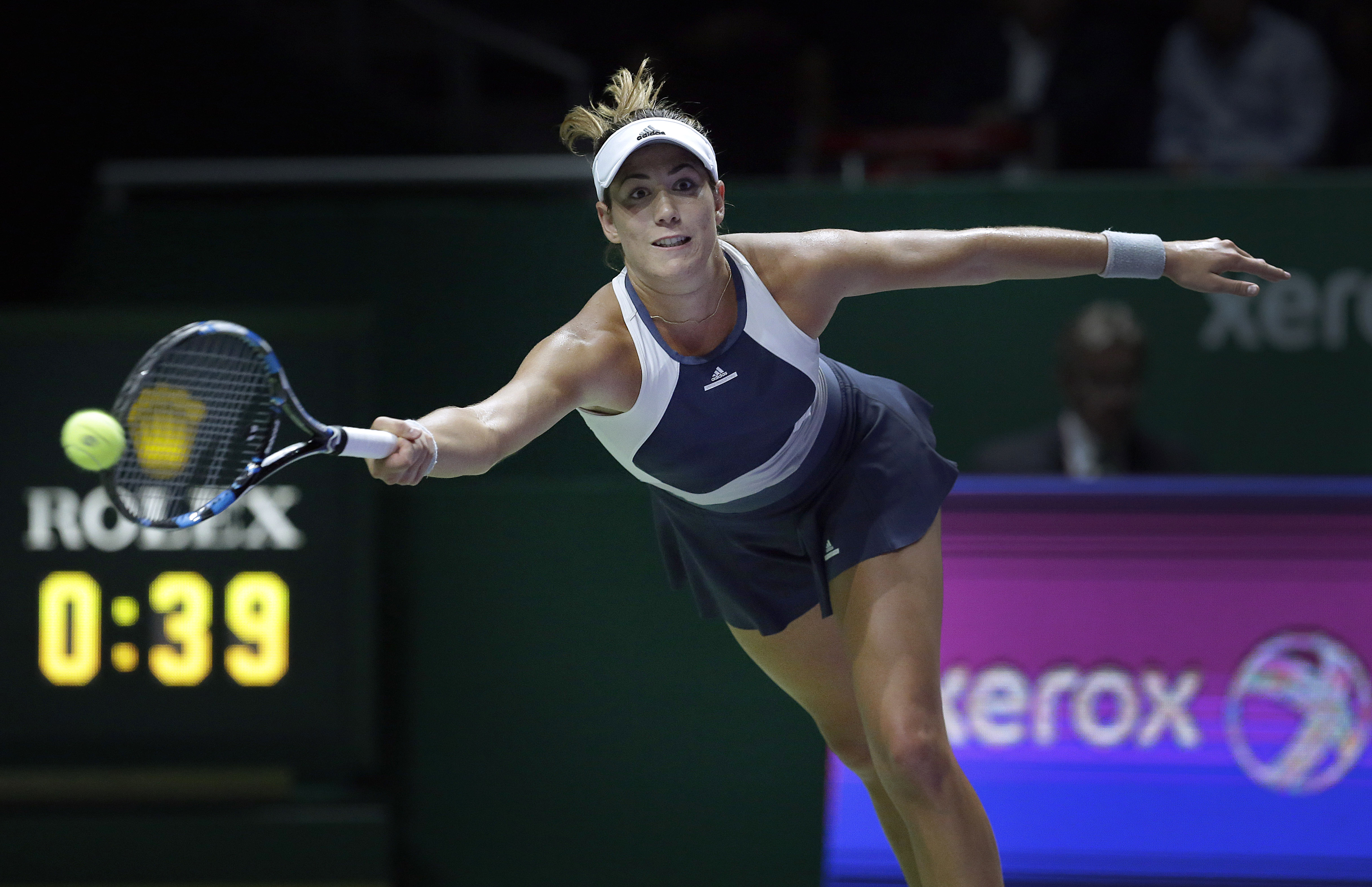 Garbine Muguruza of Spain makes a forehand return against Lucie Safarova of the Czech Republic during their singles match at the WTA tennis finals in Singapore on Monday, Oct. 26, 2015. (AP Photo/Wong Maye-E)