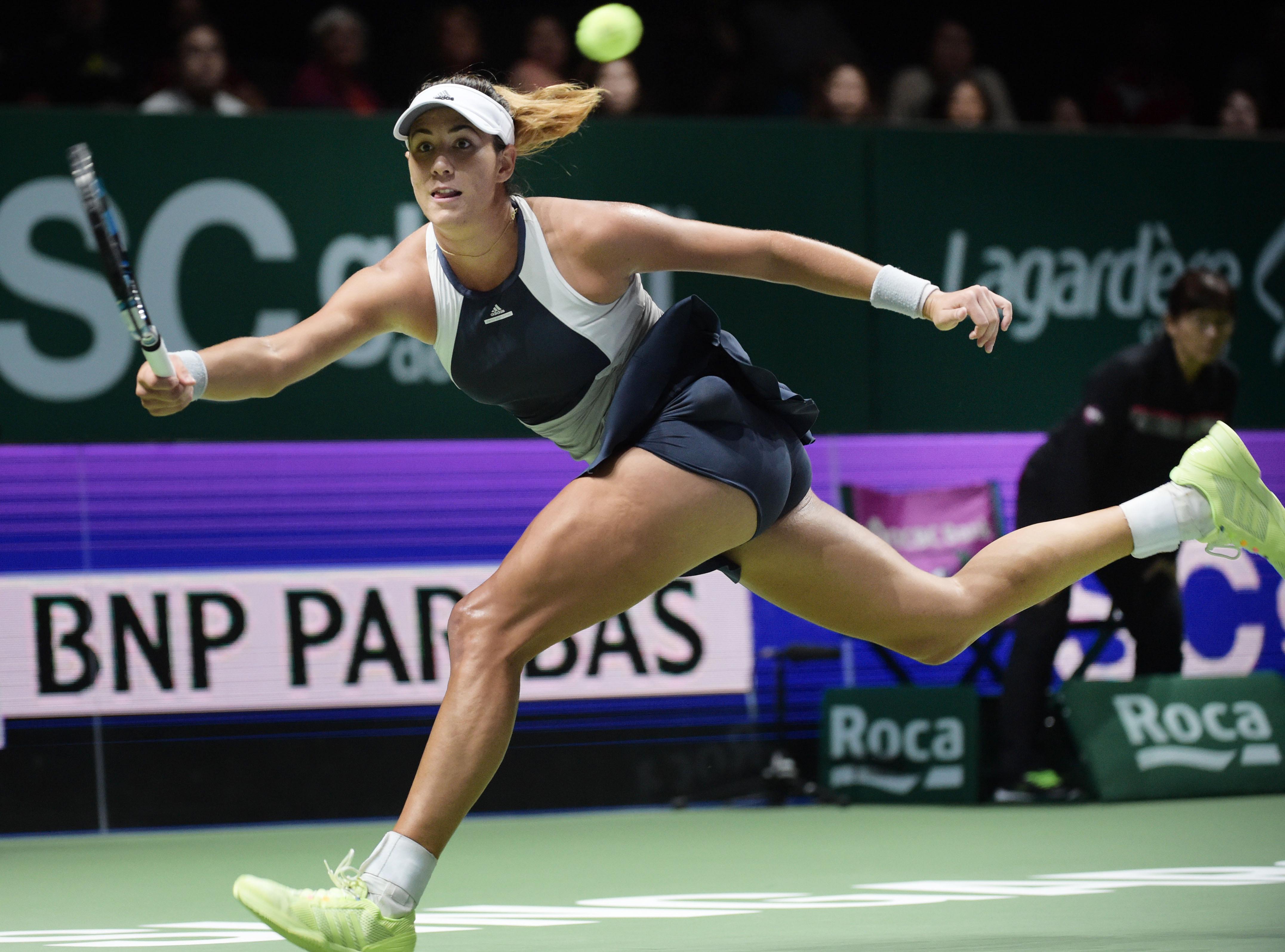Garbine Muguruza of Spain makes a forehand return against Petra Kvitova of the Czech Republic during their singles match at the WTA tennis finals in Singapore on Friday, Oct. 30, 2015.  (AP Photo/Joseph Nair)