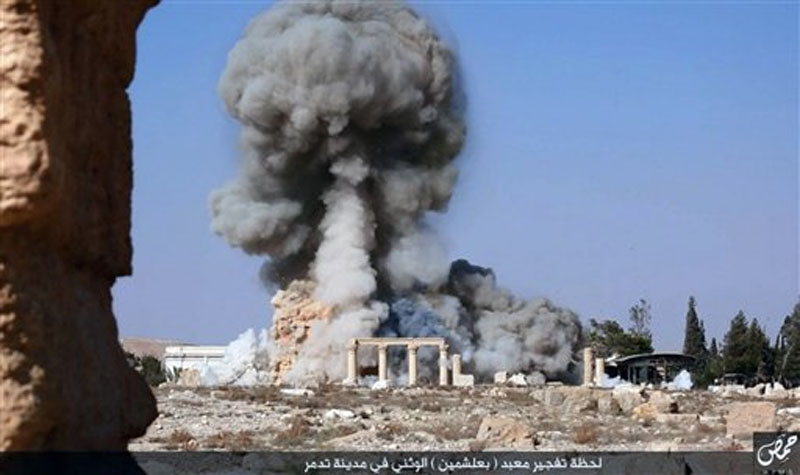 Smoke billowing from the detonation of the 2,000-year-old temple of Baalshamin in Syria's ancient caravan city of Palmyra on Tuesday, August 25, 2015. Photo: AP