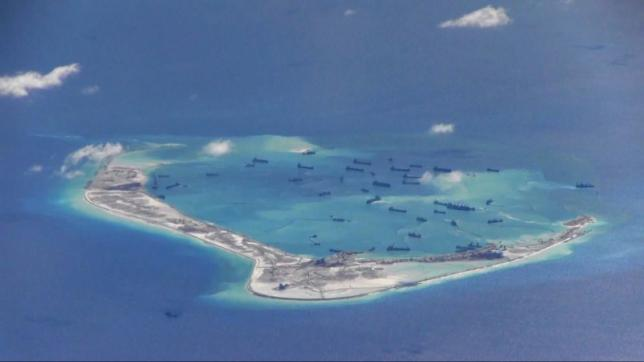 Chinese dredging vessels are purportedly seen in the waters around Mischief Reef in the disputed Spratly Islands in the South China Sea in this still image from video taken by a P-8A Poseidon surveillance aircraft provided by the United States Navy in this May 21, 2015 file photo. Photo: US Navy/Handout via Reuters