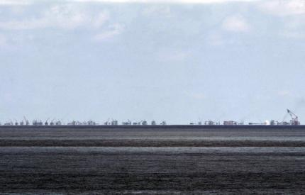 The alleged on-going land reclamation of China at Subi reef is seen from Pagasa island (Thitu Island) in the Spratlys group of islands in the South China Sea, west of Palawan, Philippines, in this May 11, 2015 file photo.  REUTERS/Ritchie B. Tongo/Pool/Files
