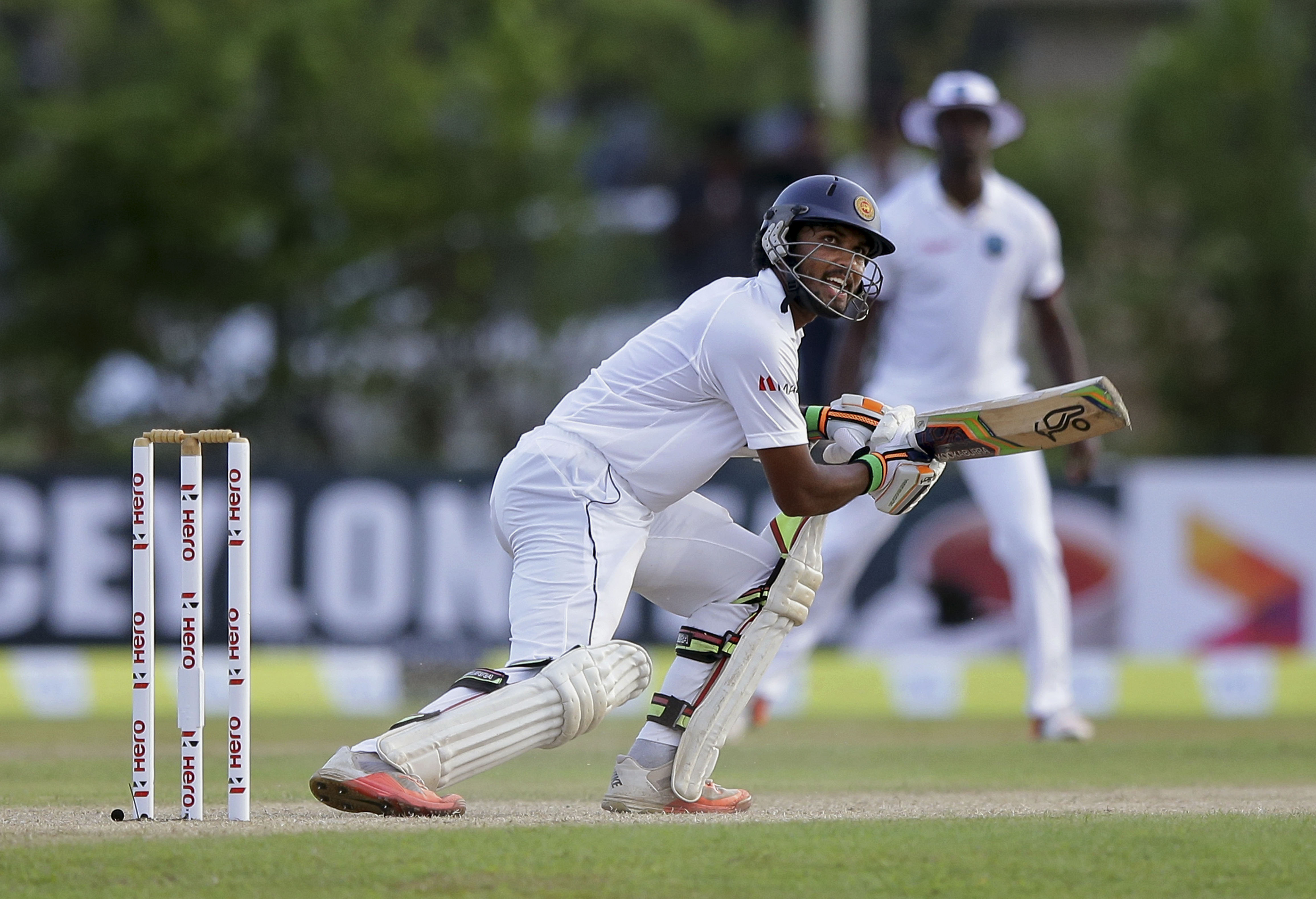 Sri Lanka's Dinesh Chandimal plays a shot during the first day of the first test cricket match against West Indies in Galle, Sri Lanka, Wednesday, Oct.14, 2015. (AP Photo/Pamod Nilru)