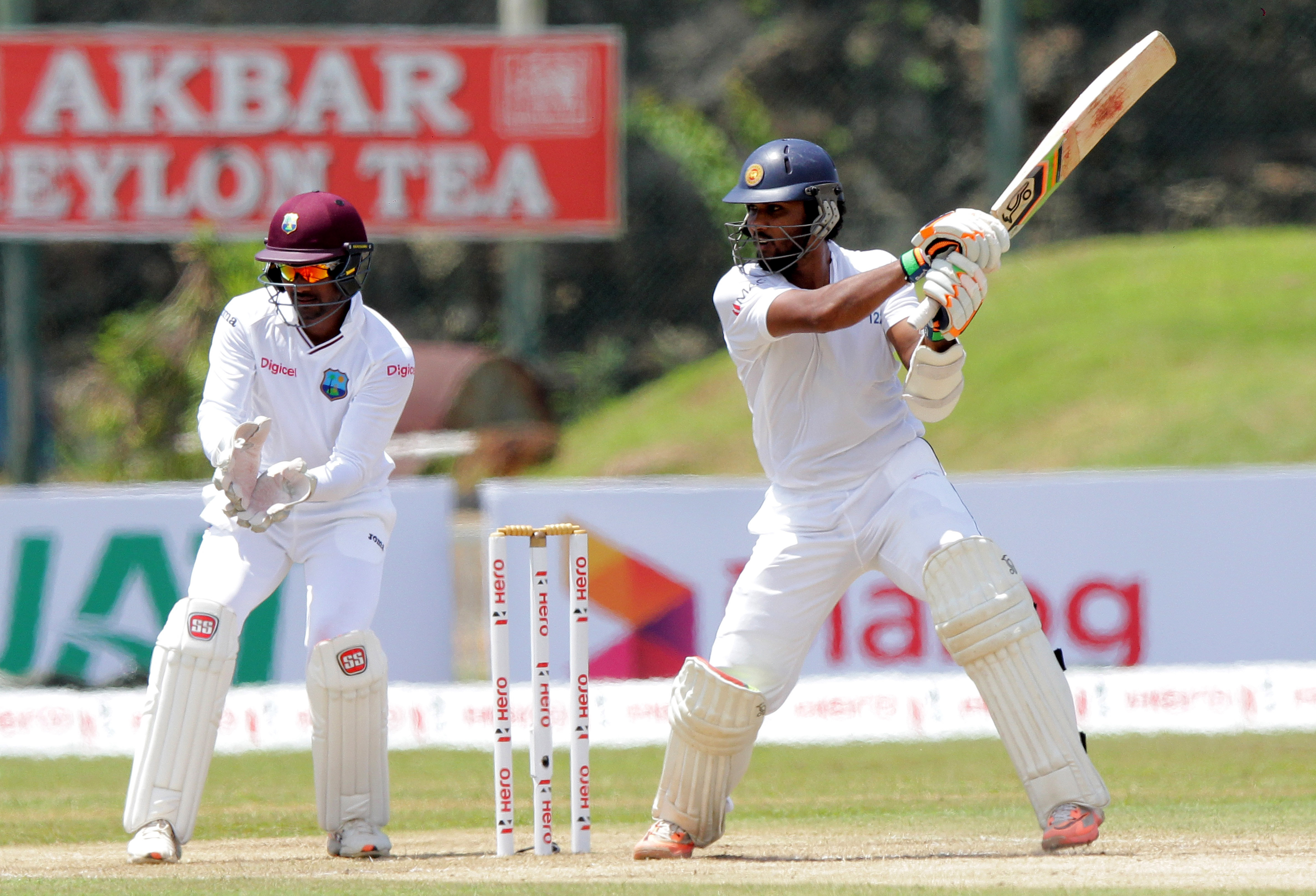 Sri Lankan cricketer Dinesh Chandimal bats, as West Indies' wicketkeeper Dinesh Ramdin looks on during the second day of the first test cricket match against West Indies in Galle, Sri Lanka, Thursday, Oct. 15, 2015. ( AP Photo/ Pamod Nilru )