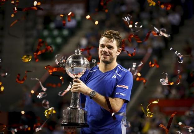 Switzerland's Stan Wawrinka holds the trophy after defeating Benoit Paire of France in the men's tennis single final of the Japan Open championships in Tokyo October 11, 2015. REUTERS/Thomas Peter