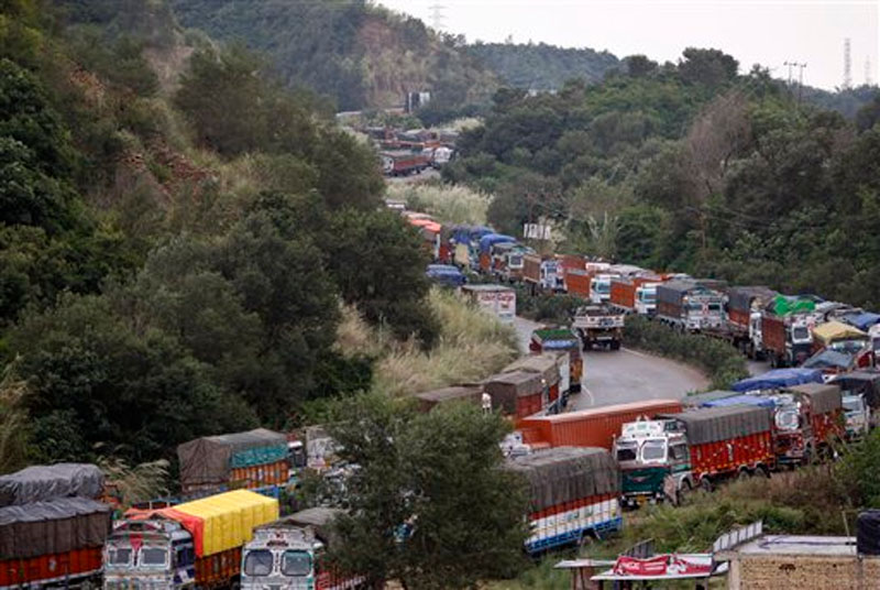 Stranded trucks stand in a line at the Jammu-Srinagar highway on the outskirts of Jammu, India, Monday, October 19, 2015. Photo: AP