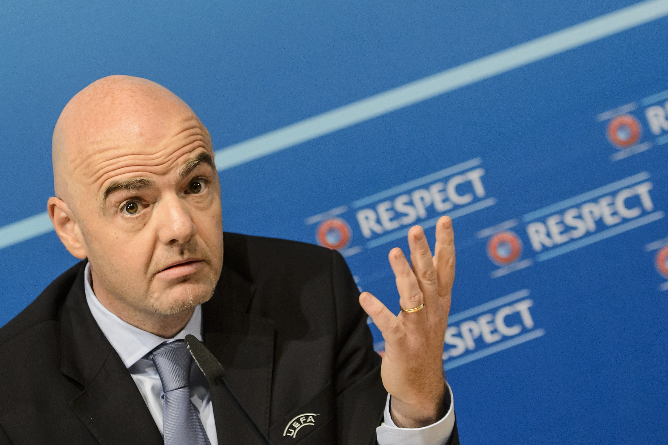 UEFA General Secretary Gianni Infantino gestures, during a press conference after the meeting of the UEFA Executive Committee and the meeting of UEFA's 54 member associations, at the UEFA Headquarters, in Nyon, Switzerland, Thursday, Oct. 15, 2015. All 54 European soccer nations decided Thursday to back Michel Platini while the UEFA president is still fighting to clear his name. (Jean-Christophe Bott, Keystone via AP)