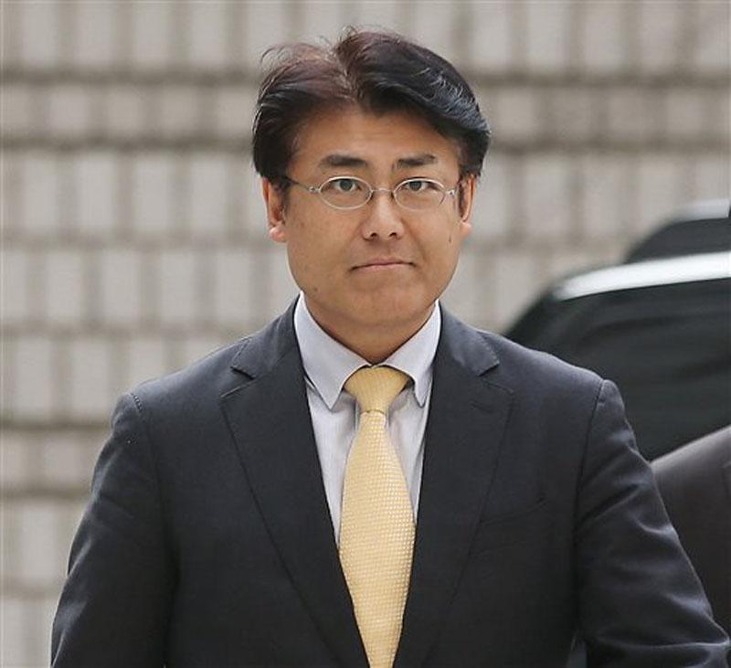 Tatsuya Kato, a former Seoul bureau chief of Japan's Sankei Shimbun, arrives at Seoul Central District Court in Seoul, South Korea on  October 19, 2015. Photo: AP