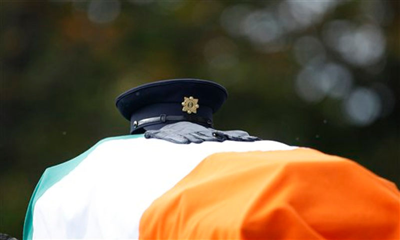 The hat and gloves of Irish police officer Tony Golden are seen as his coffin his carried for his state funeral at St Oliver Plunkett Church, Blackrock, Ireland on Thursday, October 15, 2015. Photo: AP
