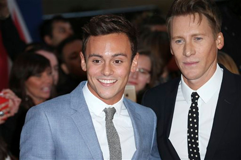 British Olympic diver Tom Daley and Oscar-winning screenwriter Dustin Lance Black, right as they pose for photographers upon arrival at the Pride of Britain Awards 2015 in London on Monday, September 28, 2015. Photo: AP