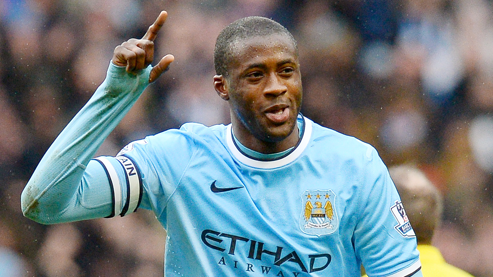 Manchester City's Ivorian midfielder Yaya Toure celebrates after scoring his team's third goal and completing his hattrick during the English Premier League football match between Manchester City and Fulham at the Etihad Stadium in Manchester, northwest England, on March 22, 2014.  AFP PHOTO / ANDREW YATES nnRESTRICTED TO EDITORIAL USE. No use with unauthorized audio, video, data, fixture lists, club/league logos or live services. Online in-match use limited to 45 images, no video emulation. No use in betting, games or single club/league/player publications.        (Photo credit should read ANDREW YATES/AFP/Getty Images)