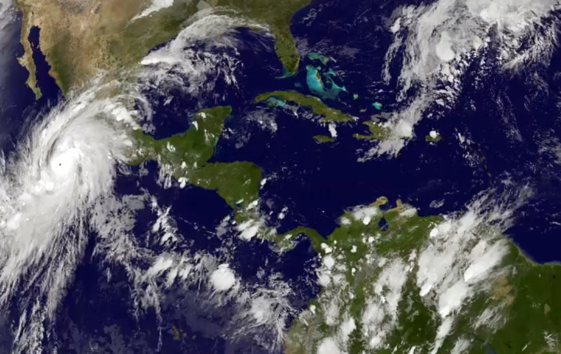 This satellite image taken at 8:45 p.m. EDT on Thursday, Oct. 22, 2015, and released by the National Oceanic and Atmospheric Administration shows Hurricane Patricia (left) moving over Mexico's central Pacific Coast. Photo: NOAA via AP